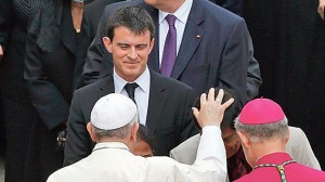 Dignitaries including France's Prime Minister Valls meet Pope Francis after the canonisation ceremony of Popes John XXIII and John Paul II in St. Peter's Square at the Vatican
