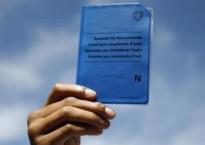 """Reuters - """"Carte bleue"""" d'un demandeur d'asile européen (ici, suisse)."""